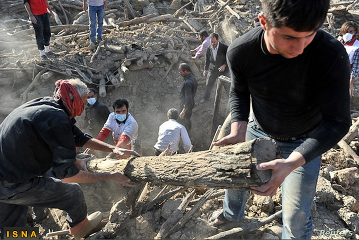 Rescue teams search for victims in the earthquake-stricken village of Varzaqan near Ahar, in East Azerbaijan province, August 12, 2012.