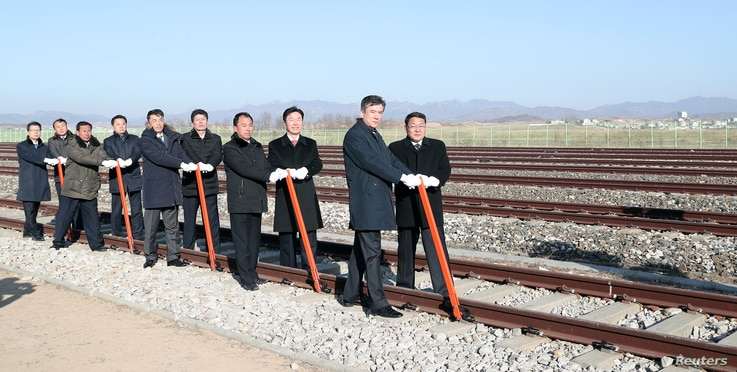 South and North Korean officials attend a groundbreaking ceremony for the reconnection of railways and roads at the Panmun Station in Kaesong, North Korea, Dec. 26, 2018. ( Yonhap via Reuters)