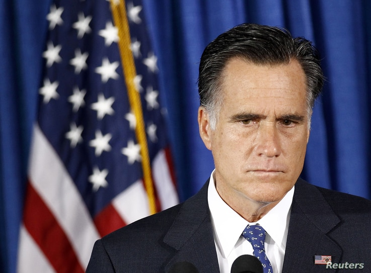 U.S. Republican presidential nominee and former Massachusetts Governor Mitt Romney listens to questions on the attack on the U.S. consulate in Libya, in Jacksonville, Florida, September 12, 2012.