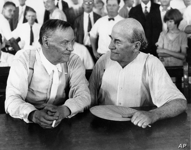 """Clarence Darrow, left, and William Jennings Bryan speak with each other at the """"monkey trial"""" in Dayton, Tenn. in 1925."""