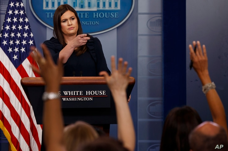 White House press secretary Sarah Huckabee Sanders calls on a reporter during the daily press briefing, Aug. 1, 2017, at the White House in Washington.