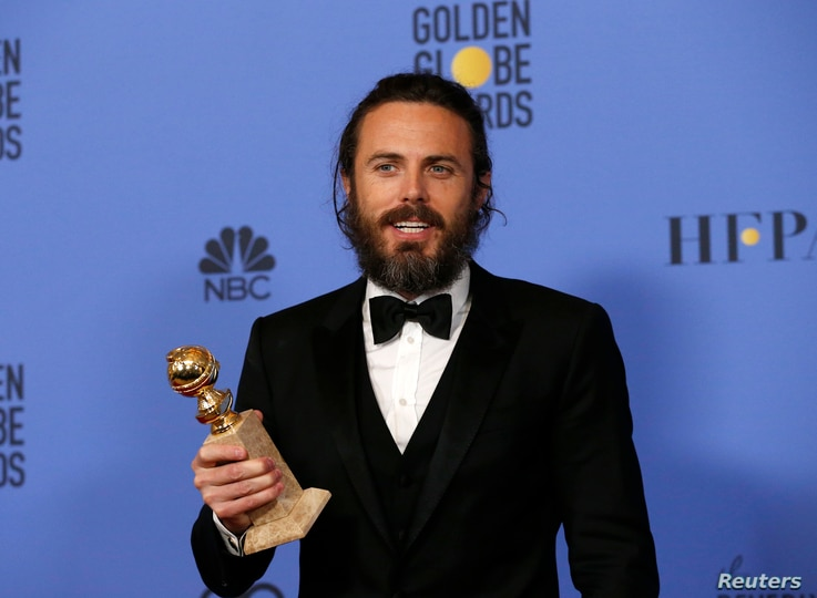 "Casey Affleck holds the award for Best Performance by an Actor in a Motion Picture - Drama for his role in ""Manchester By The Sea"" during the 74th Annual Golden Globe Awards in Beverly Hills, CA, Jan. 8, 2017."