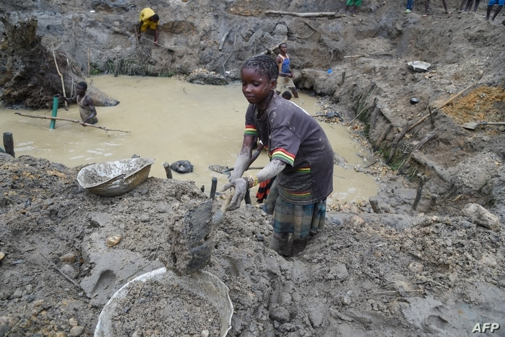 A child gold miner works on May 5, 2014 while looking for gold in a traditional mine in the village of Gam, where gold mining in the main business activity of the region.