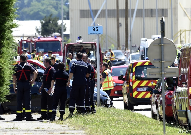 French police and firefighters gather at the entrance of the U.S.-based Air Products company in Saint-Quentin-Fallavier, near Lyon, central eastern France, June 26, 2015.