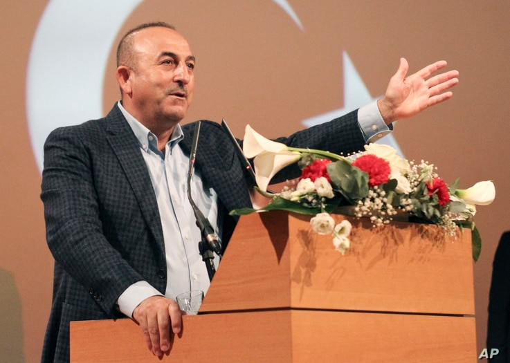 Turkish Foreign Minister Mevlut Cavusoglu, gestures as he speaks during a campaign gathering in Metz, eastern France, Sunday, March 12, 2017. Foreign Minister Mevlut Cavusoglu was in France Sunday to whip up support for controversial constitutional r...