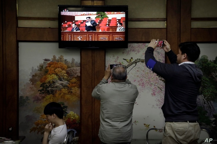 Restaurant diners watch a broadcast of the seventh congress of the Workers' Party of Korea on local television, where North Korean leader Kim Jong Un is seen delivering a speech, in Pyongyang, May 6, 2016.