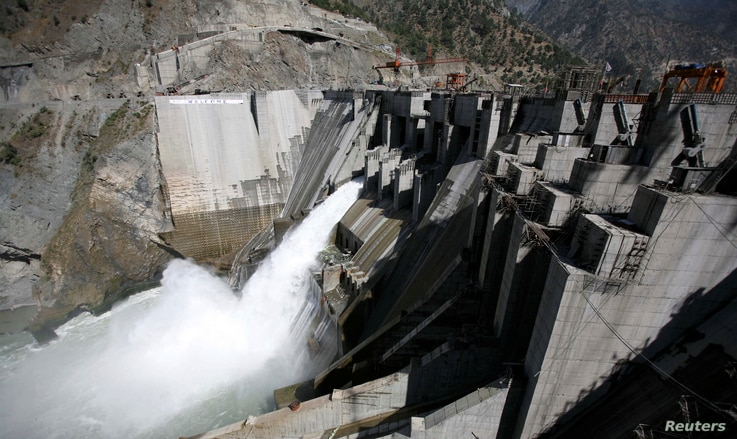 FILE - A general view of a newly inaugurated 450-megawatt hydropower project at Baglihar Dam on the Chenab River, which flows from Indian Kashmir into Pakistan, is seen at Chanderkote, about 145 km (90 miles) north of Jammu, October 10, 2008.