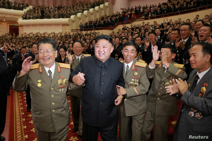 North Korean leader Kim Jong Un reacts during a celebration for nuclear scientists and engineers who contributed to a hydrogen bomb test, in this undated photo released by North Korea's Korean Central News Agency in Pyongyang, Sept. 10, 2017.