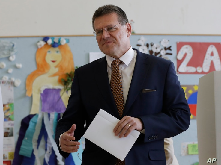 Presidential candidate and European Commission Vice President Maros Sefcovic prepares to cast his vote at a polling station during the first round of the presidential election in Bratislava, Slovakia, March 16, 2019.