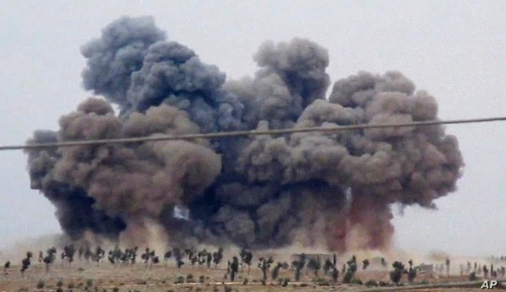 In this image made from video provided by Hadi Al-Abdallah, which has been verified and is consistent with other AP reporting, smoke rises after airstrikes in Kafr Nabel of the Idlib province, western Syria, Thursday, Oct. 1, 2015.