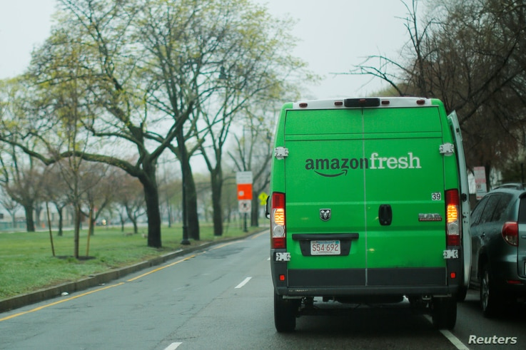 An Amazon Fresh truck makes a delivery in Cambridge, Massachusetts, U.S., April 26, 2017.