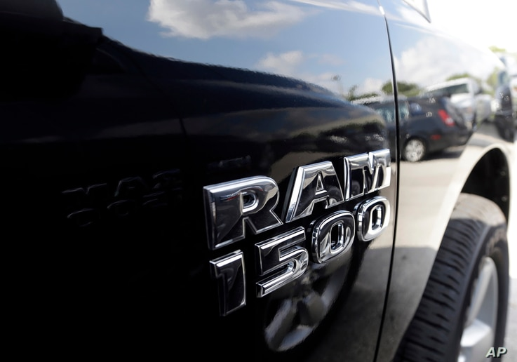 FILE - A Dodge Ram 1500 is on display on the lot at Planet Dodge in Miami, Oct. 1, 2014.