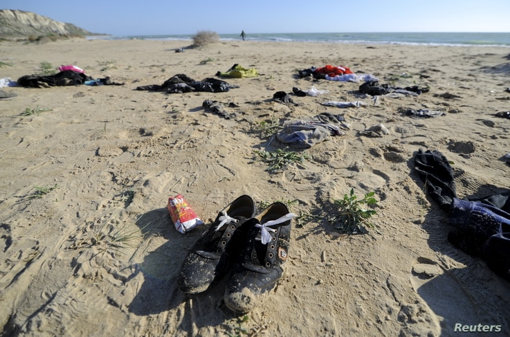 Clothes belonging to migrants lie on the beach of Siculiana, in Western Sicily, Italy, Feb. 19, 2016.