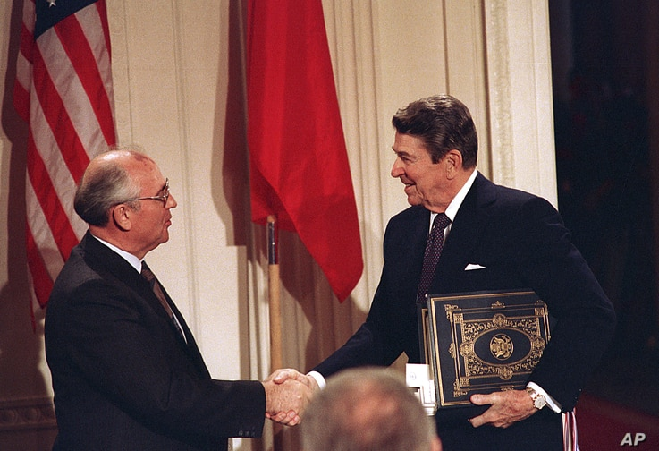 ** FILE ** U.S. President Ronald Reagan, right, shakes hands with Soviet leader Mikhail Gorbachev after the two leaders signed the Intermediate Range Nuclear Forces Treaty, Dec. 8, 1987.