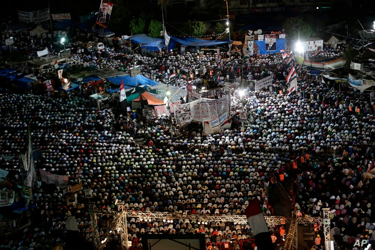 Supporters of Egypt's ousted President Mohamed Morsi pray at Nasr City, where protesters have installed a camp and hold daily rallies, in Cairo, July 28, 2013.