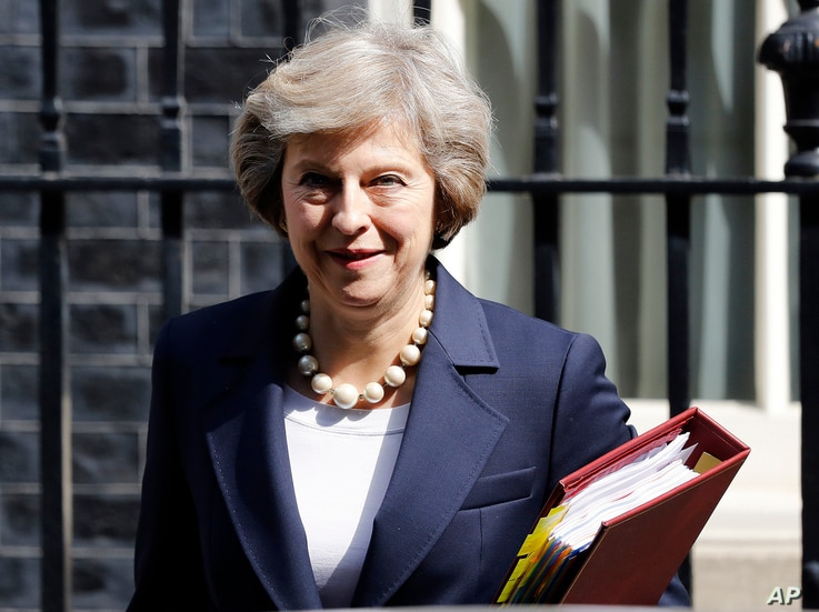FILE- Britain's Prime Minister Theresa May leaves 10 Downing street in London, July 20, 2016. On her first visit to China as Britain's prime minister, Theresa May will try to reassure Beijing that she wants to strengthen ties despite her delay on a