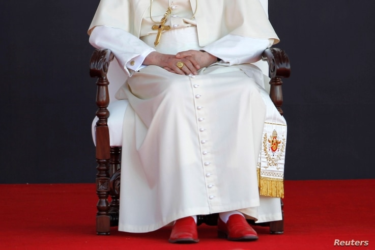 """Upon retiring Pope Benedict XVI will lay aside the red """"shoes of the fisherman"""" that have been part of his papal attire, Guanajuato airport, Silao, March 26, 2012."""