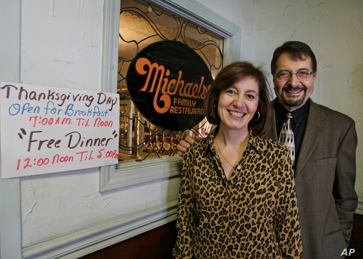Michael and Ann Petrakis pose at the entrance to their Ohio restaurant in this 2009 photo. The Petrakis family serves free turkey dinners to those in need every Thanksgiving day.