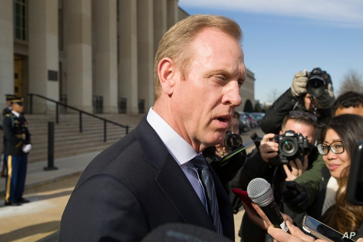 Acting Defense Secretary Patrick Shanahan speaks with the media as he waits for the arrival of NATO Secretary General Jens Stoltenberg at the Pentagon, Jan. 28, 2019, in Washington.