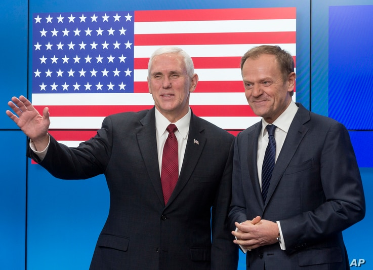 United States Vice President Mike Pence, left, gestures after shaking hands with EU Council President Donald Tusk as he arrives at the European Council building in Brussels, Belgium, on Feb. 20, 2017.