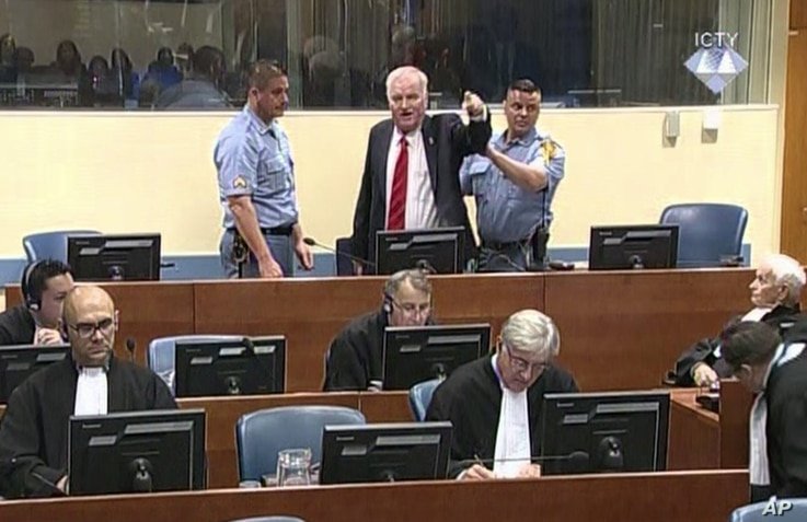 Bosnian Serb military chief Ratko Mladic during an angry outburst in the Yugoslav War Crimes Tribunal in The Hague, Netherlands, Nov. 22, 2017.