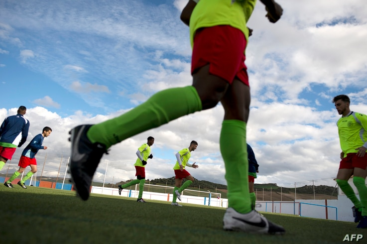 Alma de Africa Union Deportiva's players warm up before a football match against Espera CF in Espera, March 18, 2018.