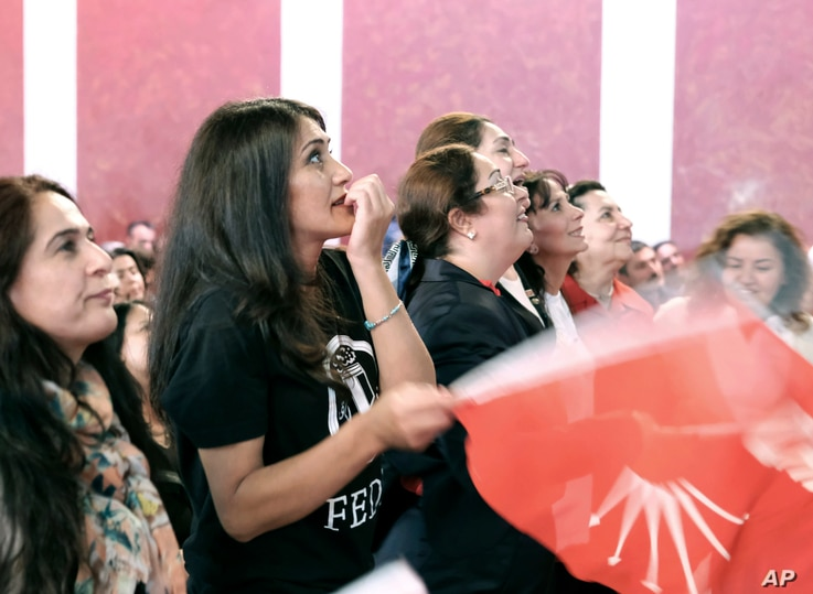People react while watching a live broadcast of the Turkish referendum results during an event organised by the Turkish Republican People's Party in Berlin, Germany, Sunday April 16, 2017.