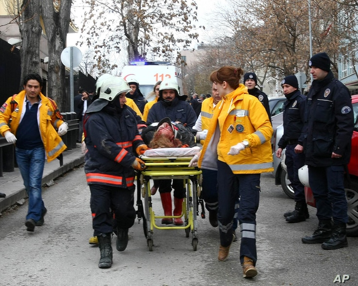 Rescuers take on February 1, 2013 a victim of a blast outside the US Embassy in Ankara to a waiting ambulance.