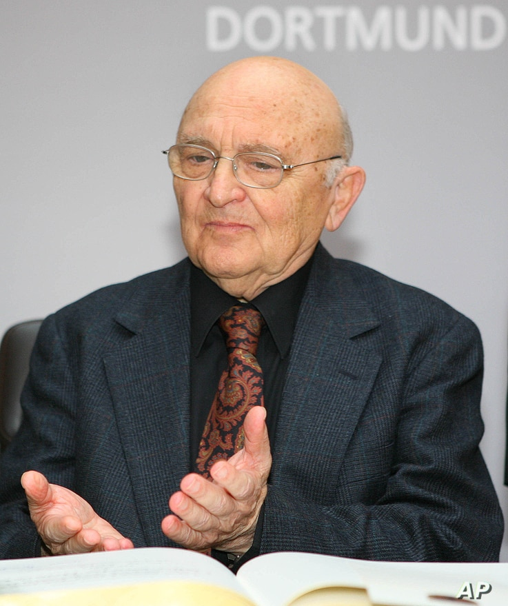 Israeli author Aharon Appelfeld gestures during the awarding ceremony of the Nelly-Sachs award for his career in Dortmund, Germany, Dec. 4, 2005.