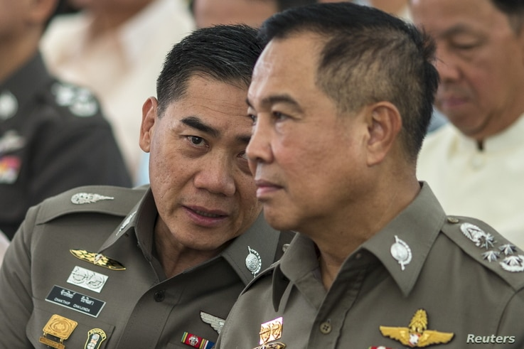 The next Thai national police chief Chakthip Chaijinda (L) talks with Thai national police chief Somyot Pumpanmuang (R) during a religious ceremony near the Erawan shrine, the site of Monday's deadly blast, in central Bangkok, Thailand, August 21, 20...