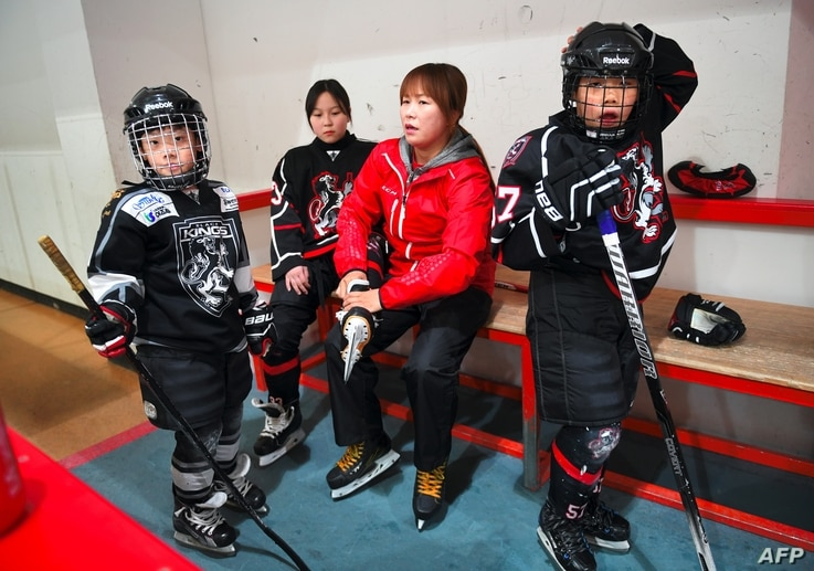 Former North Korean ice hockey player Hwangbo Young coaches an ice hockey class for children at an ice rink in Seoul, April 4, 2017.