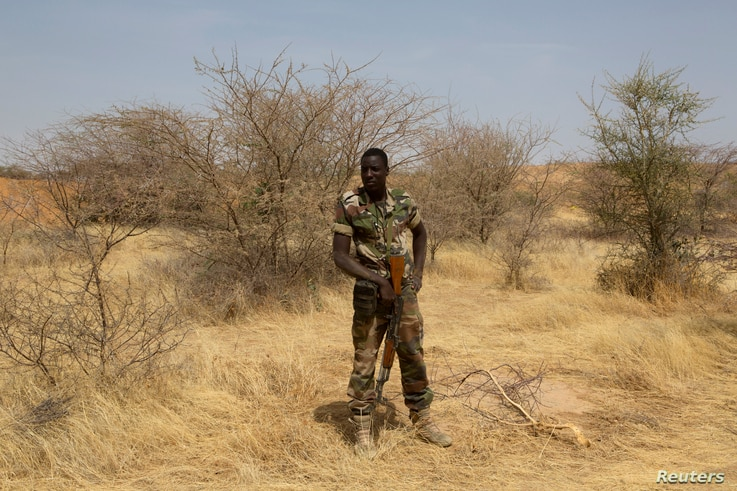 FILE - A Nigerien soldier takes a position during Flintlock 2014, a U.S.-led international training mission for African militaries, in Diffa, March 6, 2014.