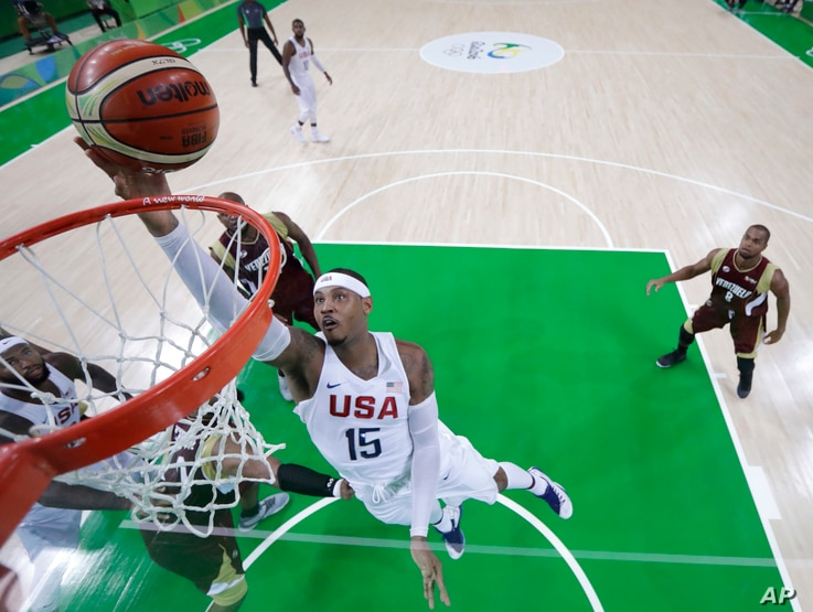 United States' Carmelo Anthony (15) scores against Venezuela during a men's basketball game at the 2016 Summer Olympics in Rio de Janeiro, Brazil, Aug. 8, 2016.