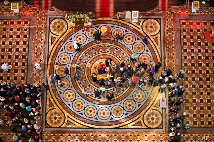 In this photo taken May 23, 2017, Russian Orthodox believers line up to kiss the relics of Saint Nicholas that were brought from an Italian church where they have lain for 930 years, in the Christ the Savior Cathedral in Moscow, Russia.