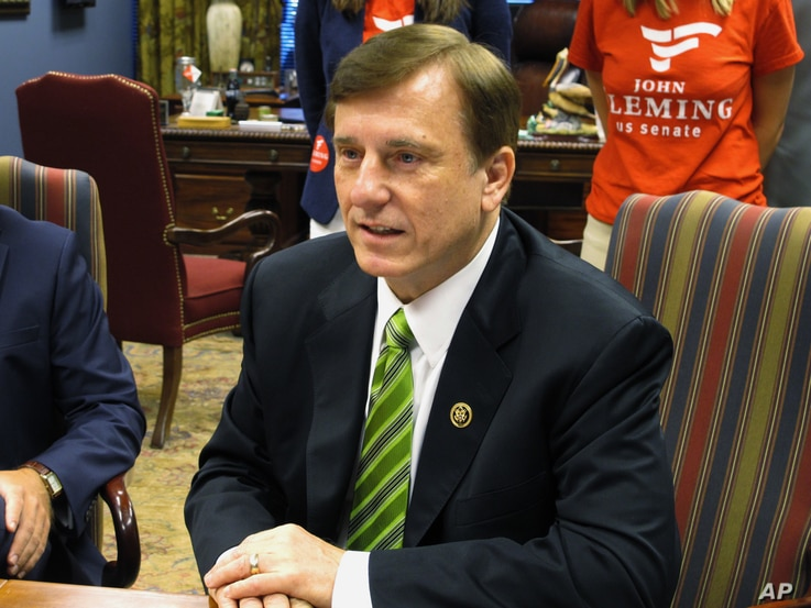 """FILE - Republican U.S. Rep. John Fleming, speaking with Louisiana election officials in Baton Rouge in July 2016, says the United States """"should not be allowing refugees from terrorist regions of the world, without proper vetting."""""""