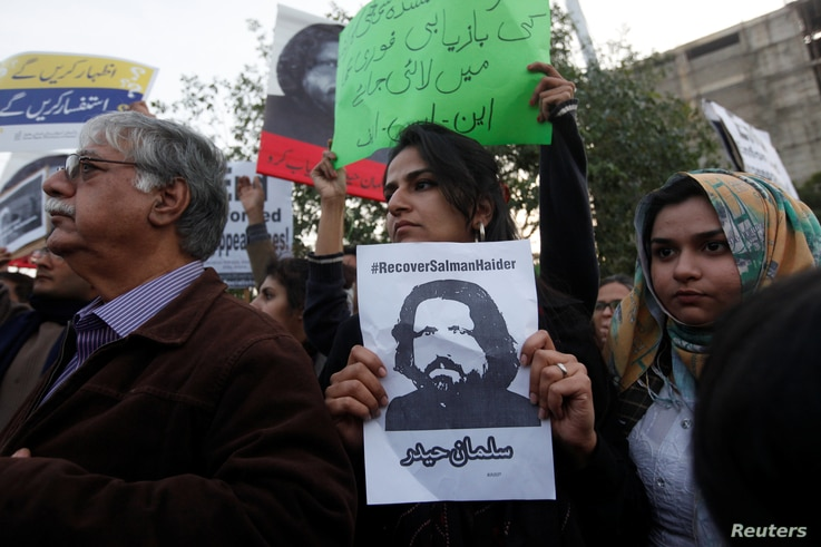 Human rights activists hold a picture of Salman Haider, who is missing, during a protest to condemn the disappearances of social activists in Karachi, Pakistan, Jan. 19, 2017.