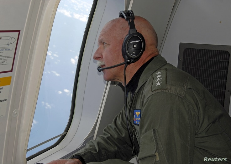 Adm. Scott Swift, commander of the U.S. Pacific Fleet, observes operations aboard a P-8A Poseidon aircraft during a flight hosted by the Pelicans of Patrol Squadron (VP) 45 in the South China Sea, July 18, 2015.