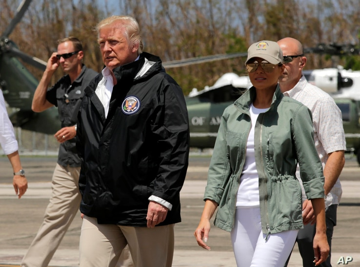 President Donald Trump and first lady Melania Trump walk after arrival at the Luis Muñiz Air National Guard Base in San Juan, Puerto Rico, Oct. 3, 2017..