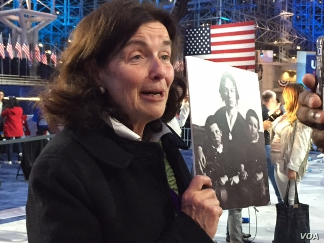 Coline Jenkins shows the picture of her great grandmother, women's rights leader Elizabeth Cady Stanton, that she carried with her Nov. 9, 2016. Jenkins said that faced with the latest loss for feminism, Stanton would look to the future.