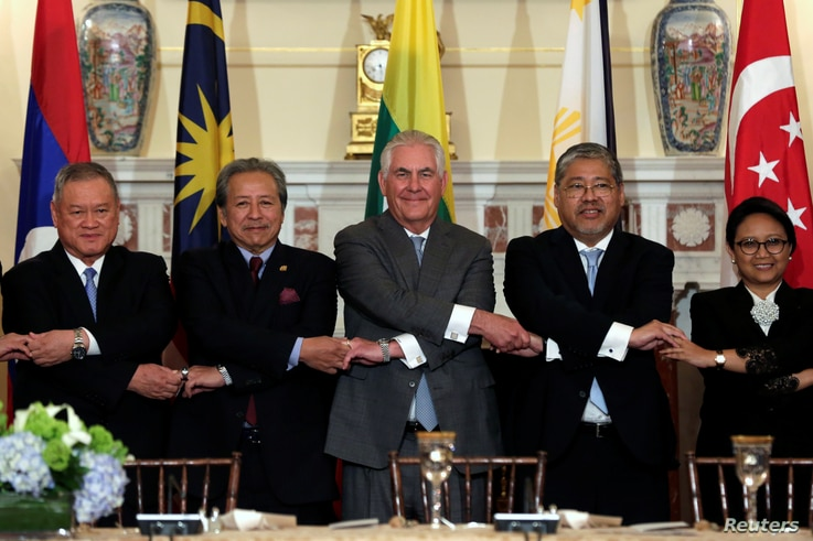 U.S. Secretary of State Rex Tillerson (C) poses with ASEAN foreign ministers before a working lunch at the State Department in Washington, U.S., May 4, 2017.