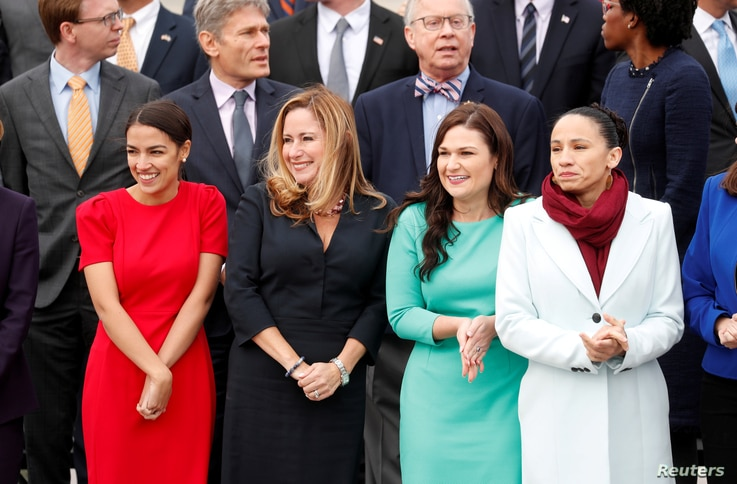 Female Democratic Representatives-elect, from left, Alexandria Ocasio-Cortez of New York, Debbie Mucarsel-Powell of Florida, Abby Finkenauer of Iowa and Sharice Davids of Kansas pose in the front row during a class picture with incoming newly elected...