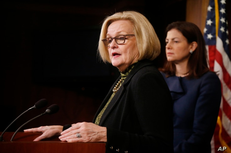 FILE - Sen. Claire McCaskill, D-Mo., left, and Sen. Kelly Ayotte, R-N.H., participate in a news conference on Capitol Hill in Washington, Thursday, March 6, 2014, following a Senate vote on military sexual assaults.