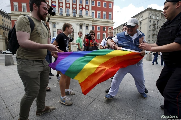 FILE PHOTO - LGBT activists are accosted by antigay protesters in central Moscow.