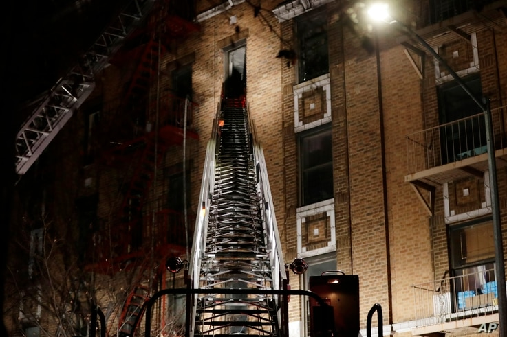 Firefighters respond to a deadly fire, Dec. 28, 2017, in the Bronx borough of New York. The New York City mayor's press secretary says several people have died and several more have been injured.