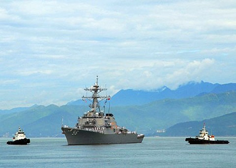 The guided-missile destroyer USS John S. McCainapproaches Da Nang, Vietnam for a scheduled five-day engagement commemorating the 15th anniversary of the normalization of relations between Vietnam and the United States