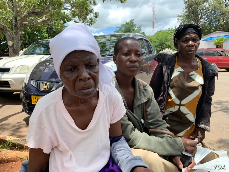 Kasirina Zibveka, 69, accompanied her daughter Margret Chikoti, center, has not been able to have her ailing lung removed since mid-December. Now her chances have begun to look up.