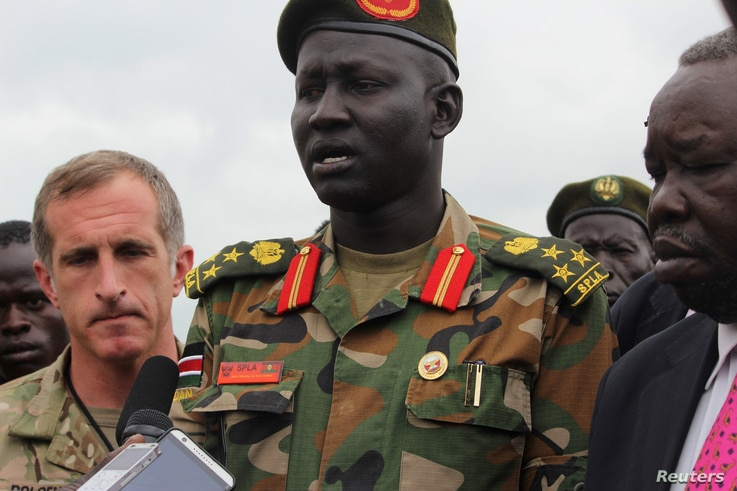 Brigadier General Lul Ruai Koang of the Sudan People's Liberation Army (SPLA) addresses the media on the killing of U.S. journalist Christopher Allen at the morgue of the military hospital in Juba, Aug. 29, 2017.