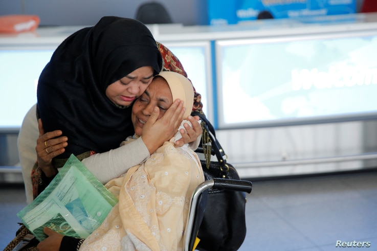 A woman greets her mother after she arrived from Dubai on Emirates Flight 203 at John F. Kennedy International Airport in Queens, New York, Jan. 28, 2017.