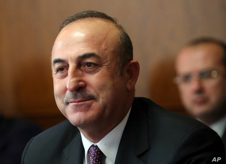 Turkish foreign minister Mevlut Cavusoglu attends a meeting on forming a constitutional committee in Syria at the European headquarters of the United Nations in Geneva, Switzerland, Dec. 18, 2018.