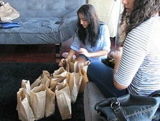 Giving to the less fortunate - these young Muslims are preparing bagged lunches for the homeless - is an important part of Ramadan.